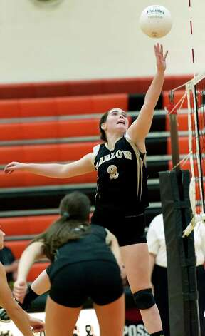 Joel Barlow high school's Victoria Shea goes up for the ball at the net in a CIAC class L semifinal girls volleyball tournament game against East Lyme high school played at Shelton high school, Shelton, CT on Thursday November 15th, 2012 Photo: Mark Conrad / Connecticut Post Freelance