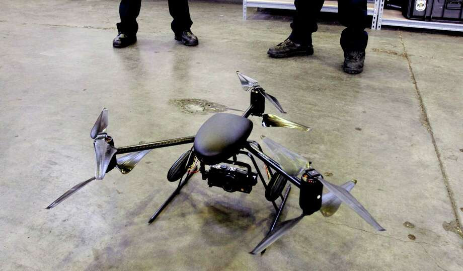 Police use of drones such as the Draganflyer X6 helicopter is raising privacy concerns among many around the nation. Photo: ALAN BERNER, MBR / Seattle Times
