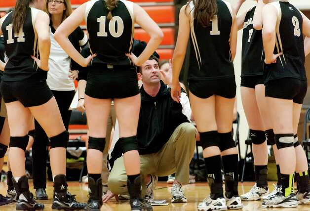 Joel Barlow high school girls volleyball head coach Steve Antal speaks to his team between games during a CIAC class L semifinal girls volleyball tournament game against East Lyme high school played at Shelton high school, Shelton, CT on Thursday November 15th, 2012 Photo: Mark Conrad / Connecticut Post Freelance