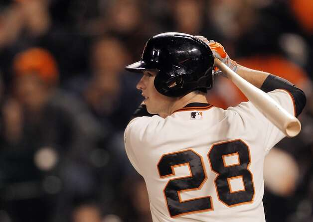 Buster Posey completes his climb to elite status by being voted MVP of the National League. Photo: Carlos Avila Gonzalez, The Chronicle