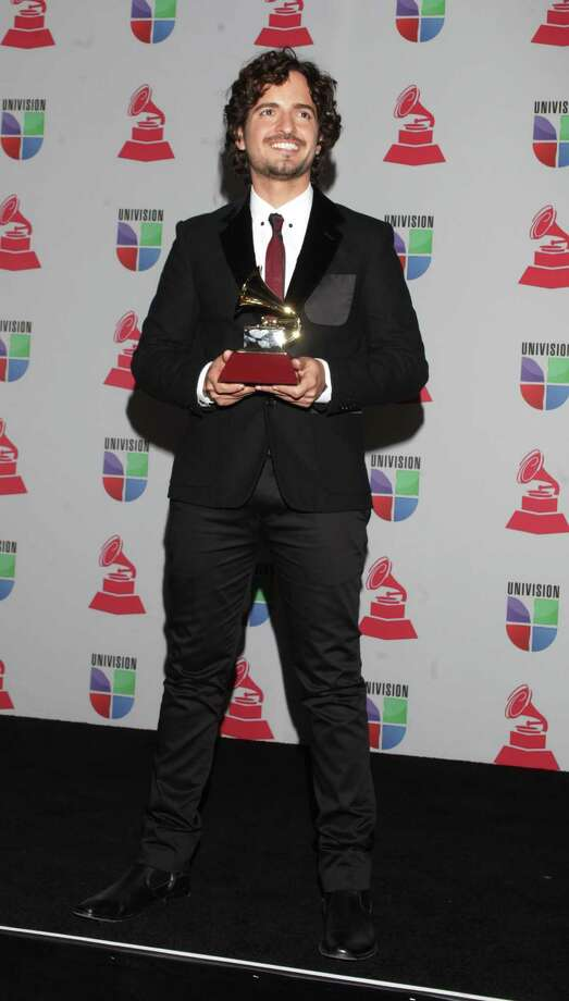 Singer Tommy Torres poses with the trophy for Song of the Year at the 13th Annual Latin Grammy Awards on November 15, 2012 in Las Vegas, Nevada.    AFP PHOTO/John GURZINSKIJOHN GURZINSKI/AFP/Getty Images Photo: JOHN GURZINSKI, Getty Images / AFP