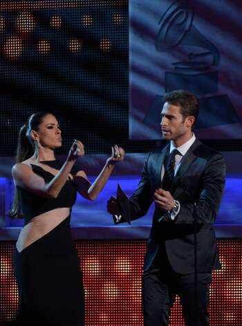 (L-R) Presenters Galilea Montijo and Sebastian Rulli speak onstage during the 13th annual Latin GRAMMY Awards held at the Mandalay Bay Events Center on November 15, 2012 in Las Vegas, Nevada. Photo: Kevork Djansezian, Getty Images / 2012 Getty Images