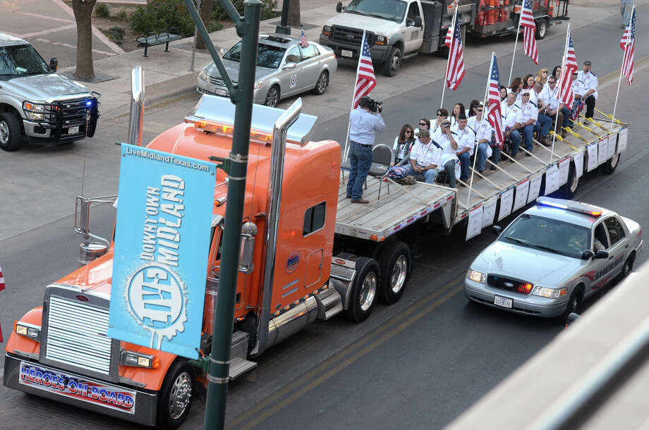 "A flatbed truck carries wounded veterans and their families during a parade before it was struck by a train Thursday, Nov. 15, 2012 in Midland, Texas. ""Show of Support"" president and founder Terry Johnson says there are ""multiple injuries"" after a Union Pacific train slammed into the trailer, killing at least four people and injuring 17 others. Photo: James Durbin, Reporter-Telegram / Reporter-Telegram"