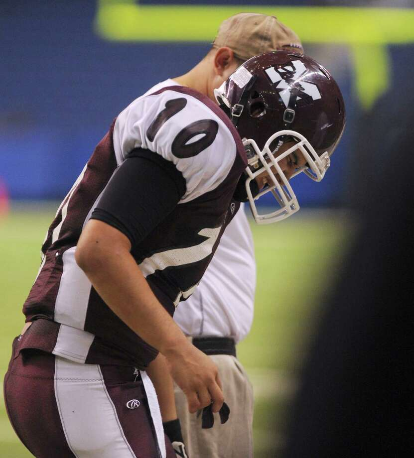 Marshall quarterback Dominic Ramirez leaves the field in pain during Class 5A Division II bidistrict playoff action against Steele at the Alamodome on Thursday, Nov. 15, 2012. Photo: Billy Calzada, Express-News / © 2012 San Antonio Express-News