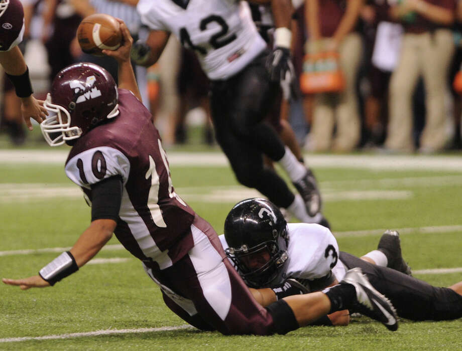 Marshall quarterback Dominic Ramirez (10) attempts to pass as he is tackled by Justin Garcia (3) of Steele during Class 5A Division II bidistrict playoff action at the Alamodome on Thursday, Nov. 15, 2012. Photo: Billy Calzada, Express-News / © 2012 San Antonio Express-News