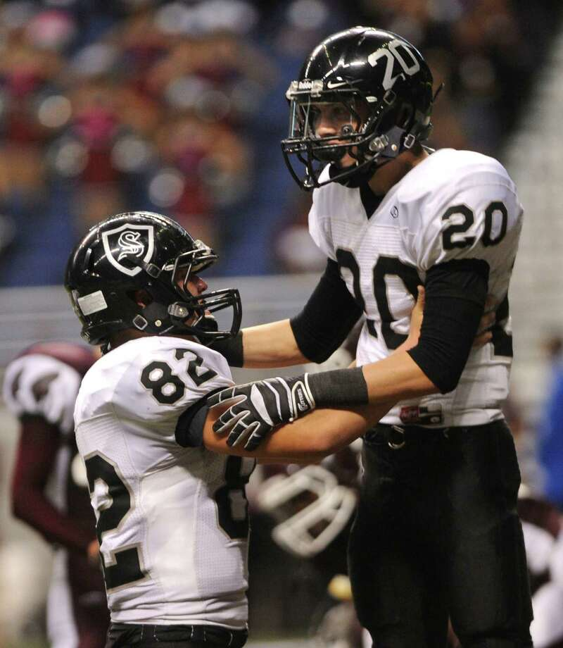Receiver Matthew Mayle (20) of Steele celebrates with teammate Matthew Moen (82) after scoring a first-half touchdown against Marshall during Class 5A Division II bidistrict playoff action at the Alamodome on Thursday, Nov. 15, 2012. Photo: Billy Calzada, Express-News / © 2012 San Antonio Express-News