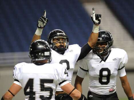 Jordan Sterns of Steele celebrates after returning a punt for a touchdown against Marshall during Class 5A Division II bidistrict playoff action at the Alamodome on Thursday, Nov. 15, 2012. Photo: Billy Calzada, Express-News / © 2012 San Antonio Express-News