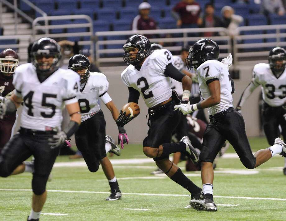 Jordan Sterns (2) of the Steele Knights returns a punt for a touchdown against Marshall during Class 5A Division II bidistrict playoff action at the Alamodome on Thursday, Nov. 15, 2012. Photo: Billy Calzada, Express-News / © 2012 San Antonio Express-News