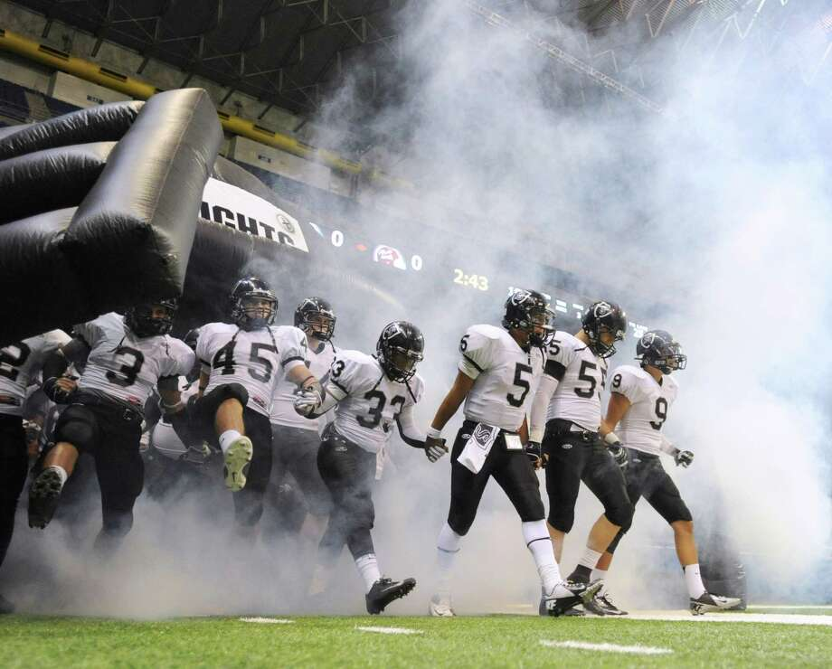 The Steele Knights enter the Alamodome for their Class 5A Division II bidistrict playoff game against Marshall on Thursday, Nov. 15, 2012. Photo: Billy Calzada, Express-News / © 2012 San Antonio Express-News
