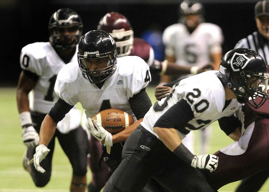 Running back Justin Stockton (4) of Steele runs for yardage against Mashall during Class 5A Division II bidistrict playoff action at the Alamodome on Thursday, Nov. 15, 2012. Photo: Billy Calzada, Express-News / © 2012 San Antonio Express-News