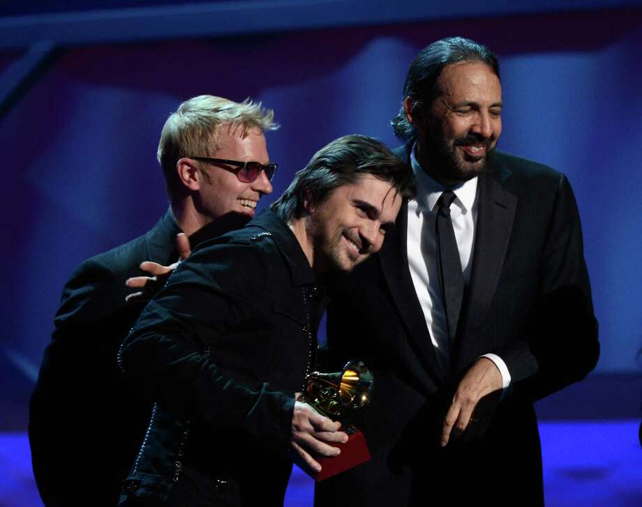 (L-R) Director Ivan Dudynsky and singers Juanes and Juan Luis Guerra accept the award for Best Long Form Music Video  onstage during the 13th annual Latin GRAMMY Awards held at the Mandalay Bay Events Center on November 15, 2012 in Las Vegas, Nevada. Photo: Kevork Djansezian, Getty Images / 2012 Getty Images