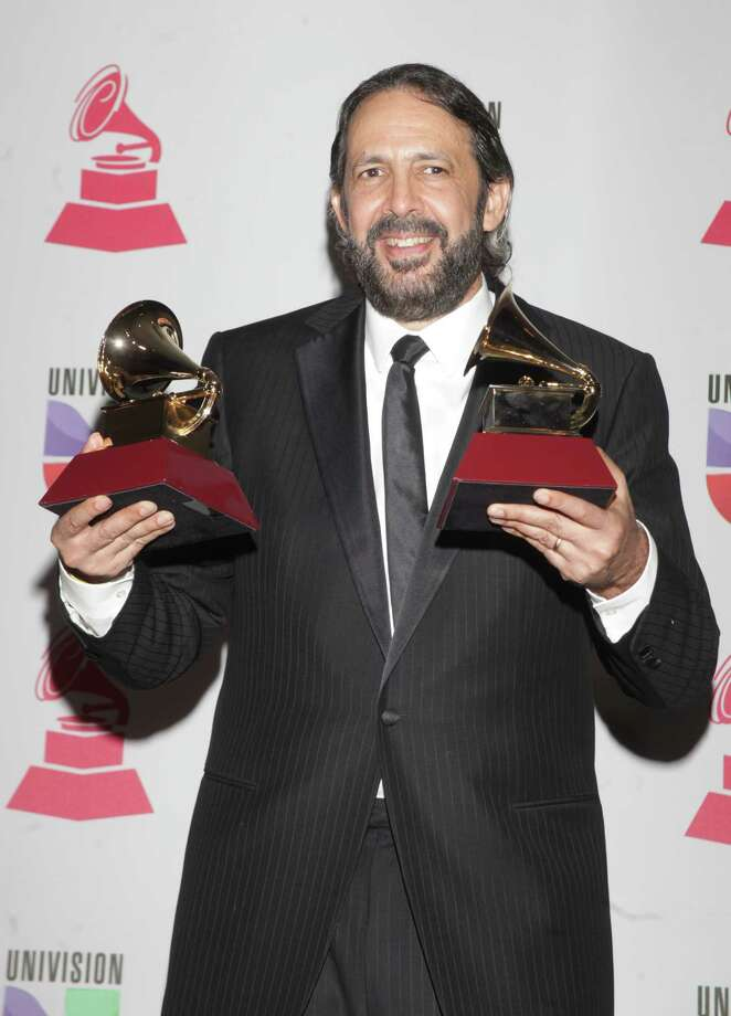 Juan Luis Guerra poses with the trophies for Album of the Year and Producer of the Year at the 13th Annual Latin Grammy Awards on November 15, 2012 in Las Vegas, Nevada.    AFP PHOTO/John GURZINSKIJOHN GURZINSKI/AFP/Getty Images Photo: JOHN GURZINSKI, Getty Images / AFP