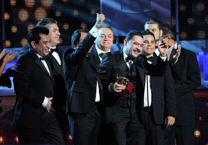 Los Tucanes De Tijuana accept the award for best norteno album for