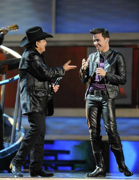 Prince Royce, right, and Joan Sebastian perform