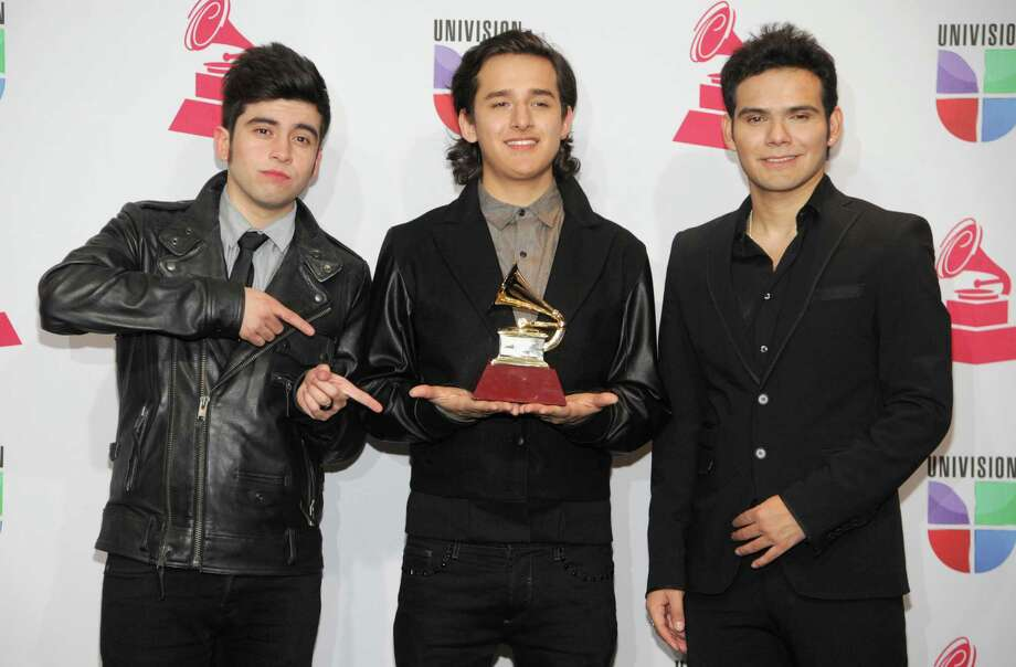 Musical group 3Ball MTY pose backstage with the best new artist award at the 13th Annual Latin Grammy Awards at Mandalay Bay on Thursday Nov. 15, 2012, in Las Vegas. (Photo by Brenton Ho/Powers Imagery/Invision/AP) Photo: Brenton Ho, Associated Press / Invision