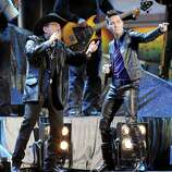 """Prince Royce, right, and Joan Sebastian perform """"Incondicional"""" at the 13th Annual Latin Grammy Awards at Mandalay Bay on Thursday Nov. 15, 2012, in Las Vegas. (Photo by Al Powers/Powers Imagery/Invision/AP)"""