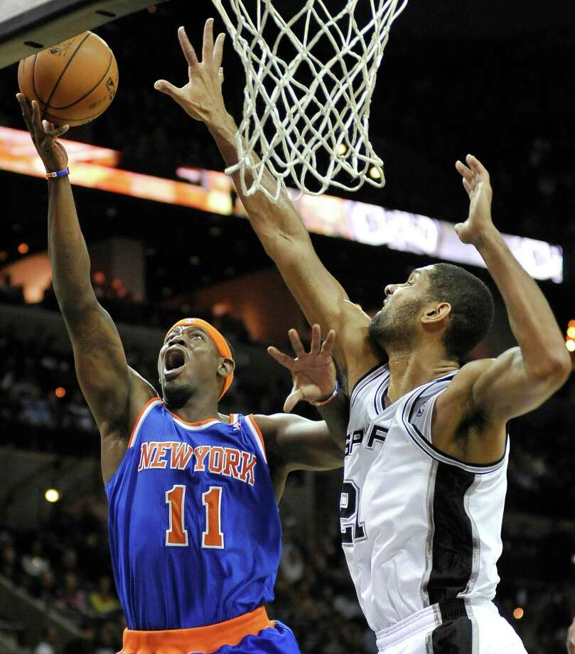 New York Knicks' Ronnie Brewer, left, shoots over San Antonio Spurs' Tim Duncan during the first half of an NBA basketball game on Thursday, Nov. 15, 2012, in San Antonio. (AP Photo/Darren Abate) Photo: Darren Abate