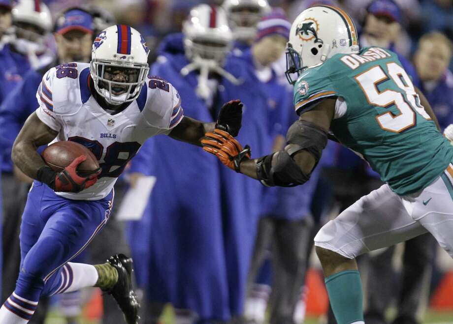 Buffalo Bills running back C.J. Spiller (28) goes against Miami Dolphins' Karlos Dansby (58) during the first half of an NFL football game on Thursday, Nov. 15, 2012, in Orchard Park, N.Y. (AP Photo/Gary Wiepert) Photo: Gary Wiepert