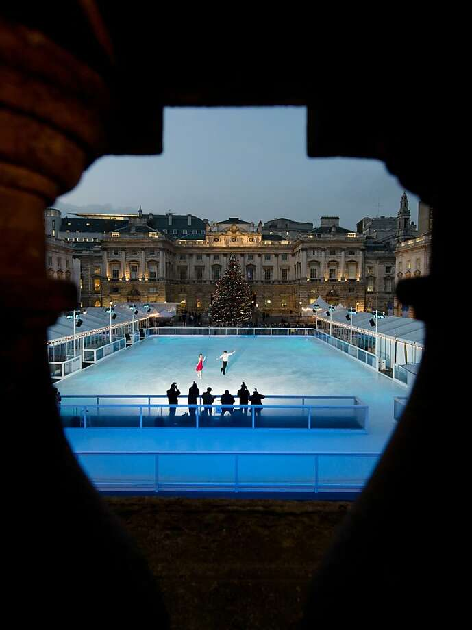 """This picture taken on November 15, 2012 show an aerial view of the Somerset House ice rink in central London as skaters perform for photographers during a media event . Open from November 16 2012 to January 6 2013, tickets start from £7.50 and themed events this year include evening """"club nights"""" with DJs performing sets as people enjoy the skating. Photo: Leon Neal, AFP/Getty Images"""