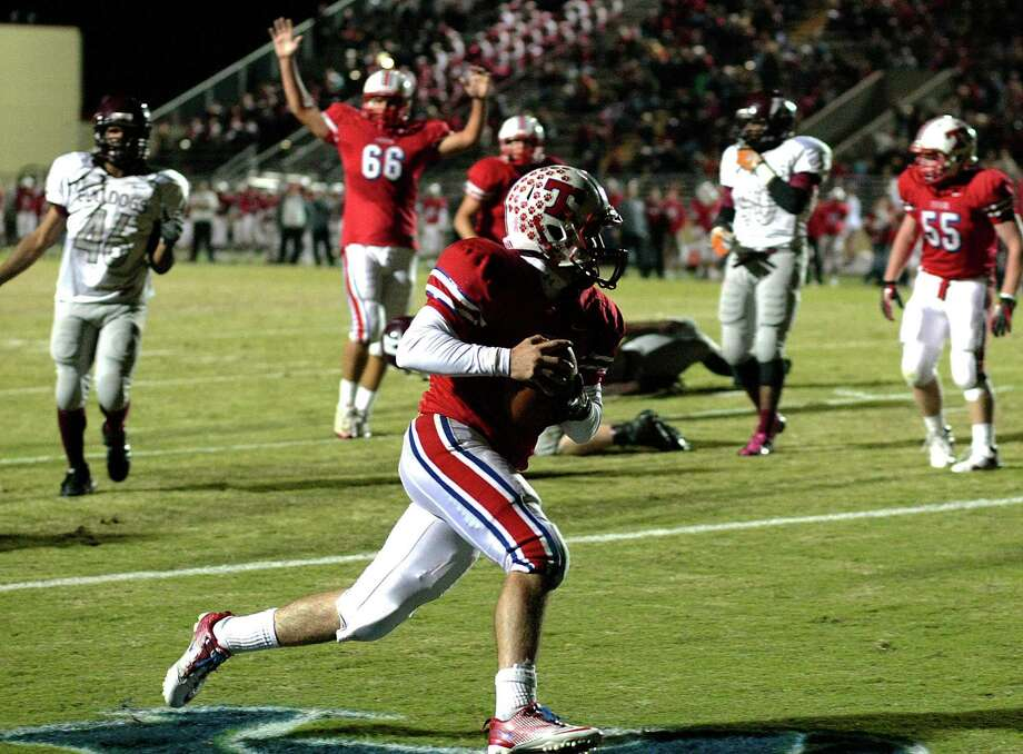 Tomball quarterback Drew Reynolds found the end zone with great regularity during Thursday night's bi-district win over Reagan. He used his legs to score twice in the first half and his arm to launch a pair of touchdown strikes in the second half. Photo: Billy Smith II, Staff / © 2012 Houston Chronicle