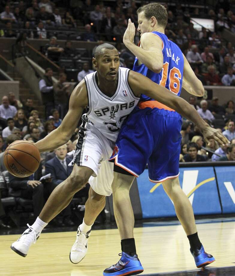 Boris Diaw makes a move around Steve Novak as San Antonio hosts the New York Knicks at the AT&T Center on November 15, 2012. (Tom Reel / San Antonio Express-News)