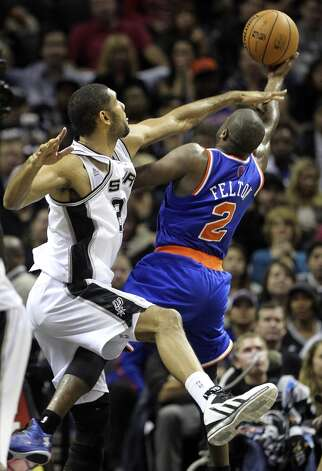 Tim Duncan can't reach Raymond Felton in time to stop a basket in the second half as San Antonio hosts the New York Knicks at the AT&T Center on November 15, 2012. (Tom Reel / San Antonio Express-News)