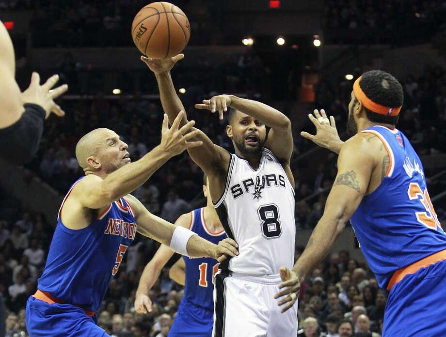 Patty Mills drives the lane and passes out to Tiago Splitter in the second half as San Antonio hosts the New York Knicks at the AT&T Center on November 15, 2012. (Tom Reel / San Antonio Express-News)