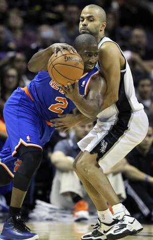 Raymond Felton controls the ball despite tight defense by Tony Parker as San Antonio hosts the New York Knicks at the AT&T Center on November 15, 2012. (Tom Reel / San Antonio Express-News)