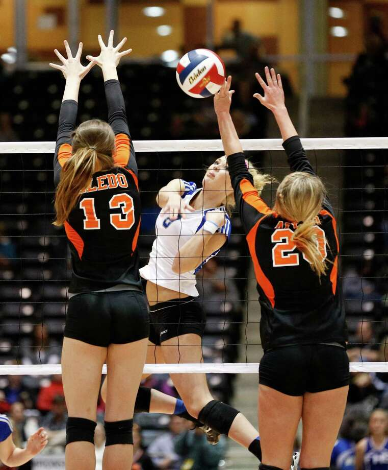 Friendswood's Jillian Bergeson (8) spikes the ball past Aledo during the class 4A semi-finals at the Curtis Culwell Center in Garland. Bergeson was named to the 2012 Under Armour All-American team. Photo: Stan Olszewski, Staff Photographer / Stan Olszewski/SOSKIphoto
