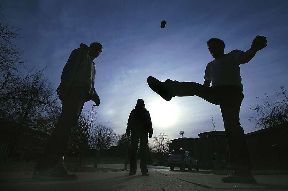 Enjoying a game of hacky sack, Marywood University seniors from left:  Nick Cornella of Long Island, N.Y., Erin Risboskin, of Forest City, Pa., and Collin Bigart of Binghamton, N.Y. take advantage of the mild weather on Thursday, Nov. 15, 2012 on campus in Scranton, Pa. Photo: Butch Comegys, Associated Press