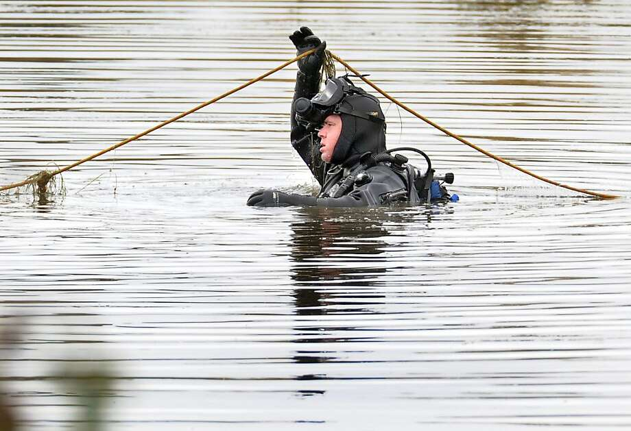 Divers seach a pond near Talent, Ore. after police served three search warrants in Ashland and on the outskirts of Talent, Thursday, Nov. 15, 2012 looking for evidence related to the nearly year-old investigation into the brutal murder of David Grubbs. Photo: Bob Pennell, Associated Press