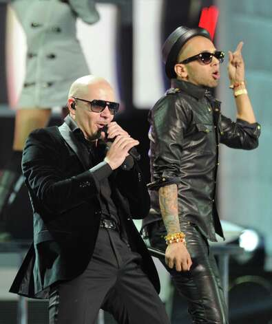 Pitbull, left, and Sensato perform at the 13th Annual Latin Grammy Awards at Mandalay Bay on Thursday, Nov. 15, 2012, in Las Vegas. (Photo by Al Powers/Powers Imagery/Invision/AP) Photo: Al Powers, Associated Press / Invision