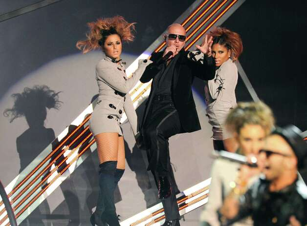 Pitbull performs onstage at the 13th Annual Latin Grammy Awards at Mandalay Bay on Thursday, Nov. 15, 2012, in Las Vegas. (Photo by Al Powers/Powers Imagery/Invision/AP) Photo: Al Powers, Associated Press / Invision