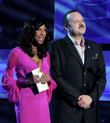 Natalie Cole, left, and Pepe Aguilar present the album of the year at the 13th Annual Latin Grammy Awards at Mandalay Bay on Thursday, Nov. 15, 2012, in Las Vegas. (Photo by Al Powers/Powers Imagery/Invision/AP) Photo: Al Powers, Associated Press / Invision