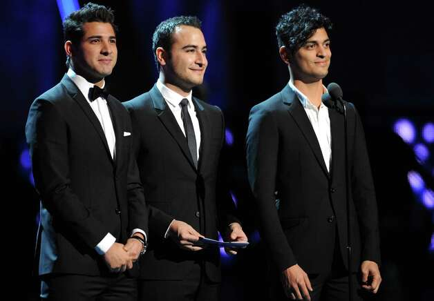 Members of the musical group Reik present the award for best tropical contemporary album at the 13th Annual Latin Grammy Awards at Mandalay Bay on Thursday, Nov. 15, 2012, in Las Vegas. From left, Julio Ramirez Eguia, Jesus Alberto Navarro Rosas and Gilberto Marin Espinoza. (Photo by Al Powers/Powers Imagery/Invision/AP) Photo: Al Powers, Associated Press / Invision