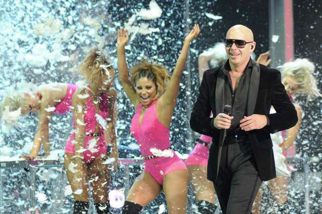 Pitbull performs onstage at the 13th Annual Latin Grammy Awards at Mandalay Bay on Thursday Nov. 15, 2012, in Las Vegas. (Photo by Al Powers/Powers Imagery/Invision/AP) Photo: Al Powers, Associated Press / Invision