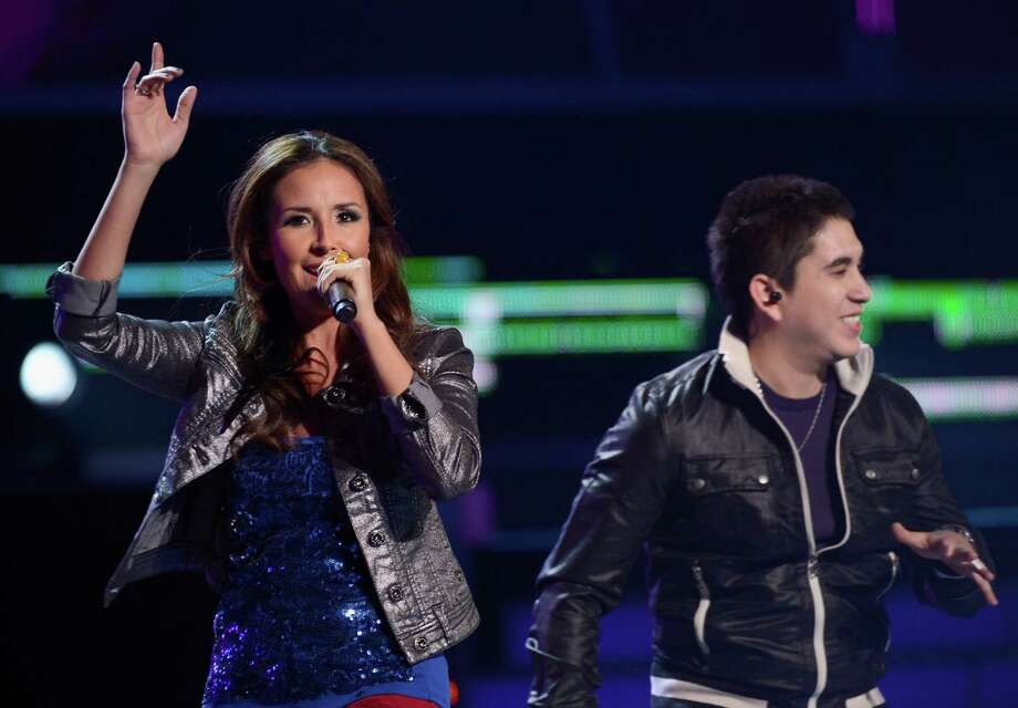 Recording artists America Sierra and Bebeto perform onstage during the 13th annual Latin GRAMMY Awards held at the Mandalay Bay Events Center on November 15, 2012 in Las Vegas, Nevada. Photo: Kevork Djansezian, Getty Images / 2012 Getty Images