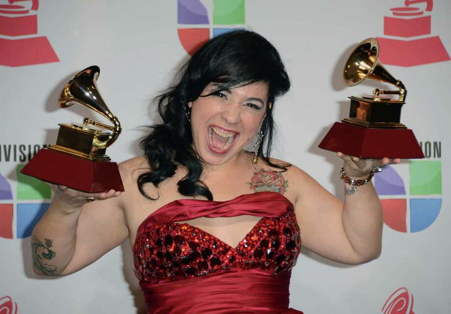 Singer Carla Morrison poses with the awards for Best Alternative Music Album and Best Alternative Song in the press room during the 13th annual Latin GRAMMY Awards held at the Mandalay Bay Events Center  on November 15, 2012 in Las Vegas, Nevada. Photo: Jason Merritt, Getty Images / 2012 Getty Images