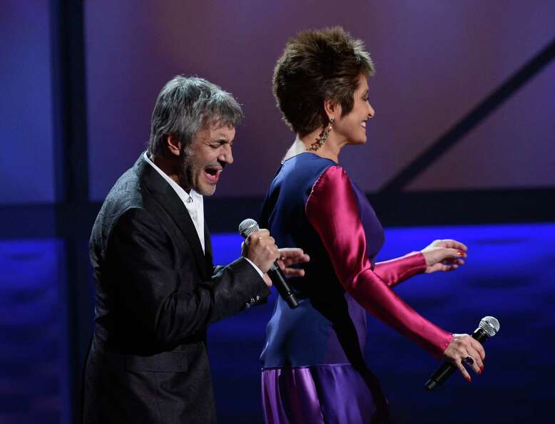 Singers Sergio Dalma (L) and Daniela Romo onstage during the 13th annual Latin GRAMMY Awards held at
