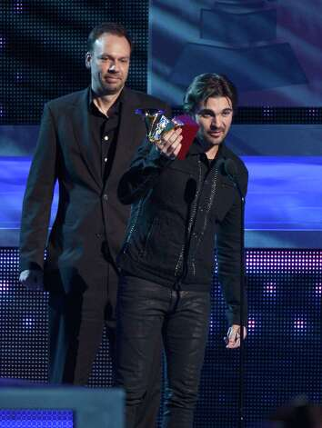 Recording artists Gustavo Borner and Juanes accept an award onstage during the 13th annual Latin GRAMMY Awards held at the Mandalay Bay Events Center on November 15, 2012 in Las Vegas, Nevada. Photo: Kevork Djansezian, Getty Images / 2012 Getty Images
