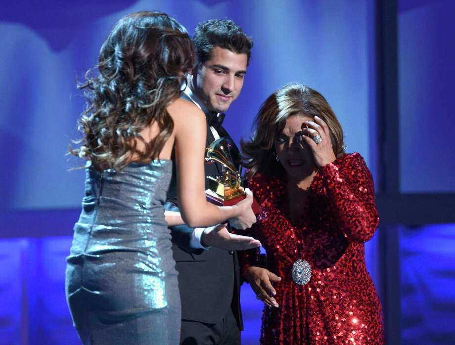 Singer Milly Quezada (R) accepts the award for Best Contemporary Tropical Album from Julio Ramirez of the musical group Reik onstage during the 13th annual Latin GRAMMY Awards held at the Mandalay Bay Events Center on November 15, 2012 in Las Vegas, Nevada. Photo: Kevork Djansezian, Getty Images / 2012 Getty Images