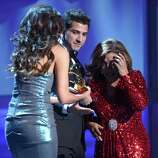 Singer Milly Quezada (R) accepts the award for Best Contemporary Tropical Album from Julio Ramirez of the musical group Reik onstage during the 13th annual Latin GRAMMY Awards held at the Mandalay Bay Events Center on November 15, 2012 in Las Vegas, Nevada.