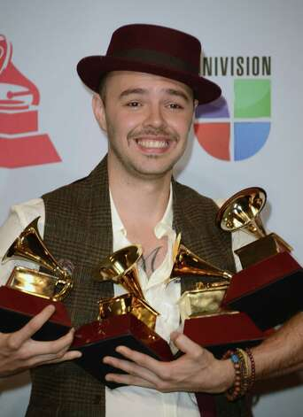 Musician Jesse Huerta of Jesse y Joy poses with the awards for Record of the Year, Best Contemporary Pop Vocal Album and Best Short Form Music Video in the press room during the 13th annual Latin GRAMMY Awards held at the Mandalay Bay Events Center  on November 15, 2012 in Las Vegas, Nevada. Photo: Jason Merritt, Getty Images / 2012 Getty Images