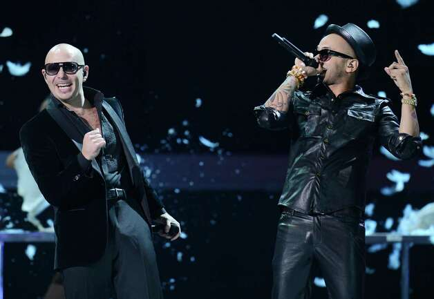 Pitbull (L) and Sensato perform during the 13th Annual Latin Grammy show on November 15, 2012 in Las Vegas, Nevada.  AFP PHOTO/Robyn BECKROBYN BECK/AFP/Getty Images Photo: ROBYN BECK, Getty Images / AFP