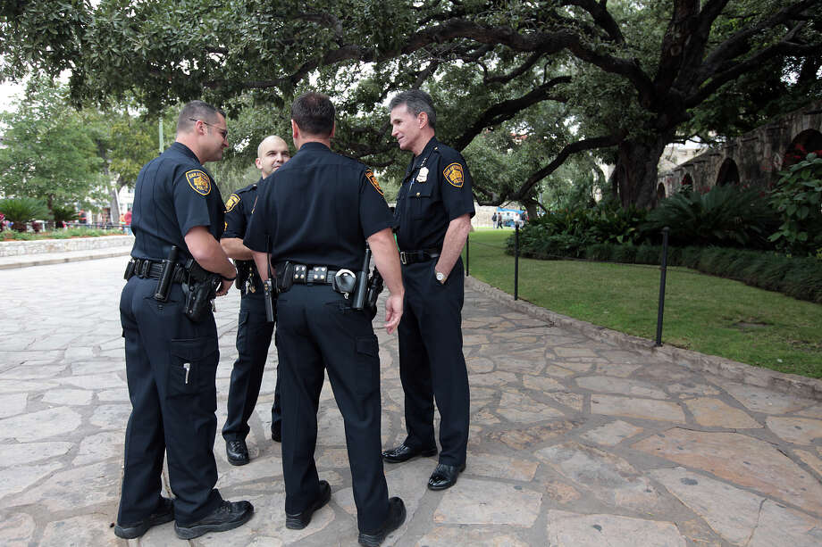 San Antonio Police Chief William McManus, right, after a press conference at Alamo Plaza, Thursday, Nov. 15, 2012. Two relics were reported stolen from the Alamo. Photo: Jerry Lara, San Antonio Express-News / © 2012 San Antonio Express-News