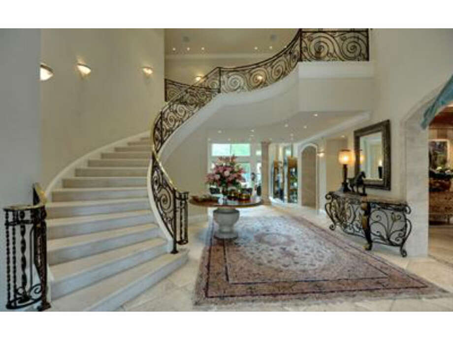 Elegant stairwell leads to the 2nd floor (Redfin.com)