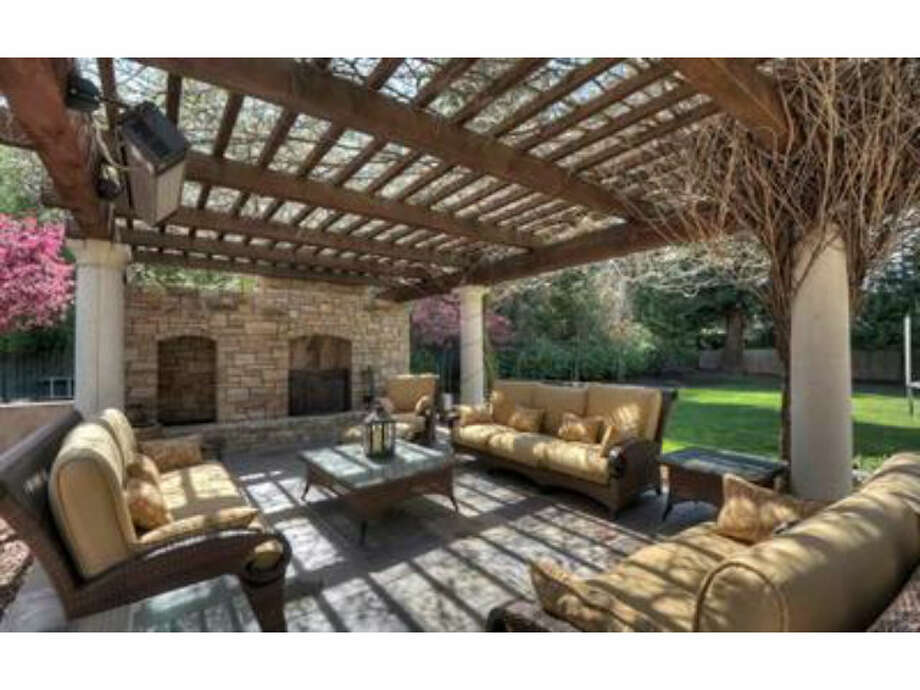 Outdoor living area with fireplace (Redfin.com)