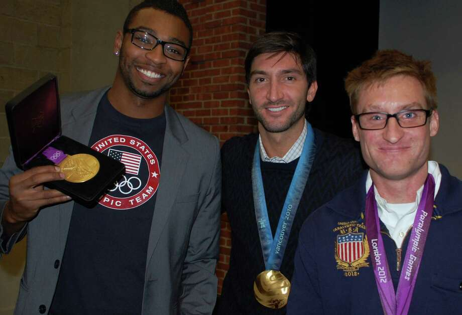 Cullen Jones, Olympic swimming champion; Evan Lysacek, Olympic figure skating champ, and Brad Snyder, a medal winner at the Paralympics, told Fairfield Country Day School students about the importance of setting personal goals during a joint appearance at the school Thursday.  Fairfield CT 11/15/12 Photo: Jarret Liotta / Fairfield Citizen contributed
