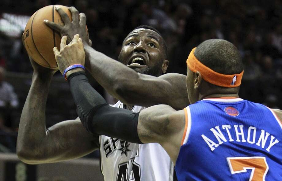 DeJuan Blair gets set for a shot against Carmelo Anthony as San Antonio hosts the New York Knicks at the AT&T Center on November 15, 2012. (San Antonio Express-News)