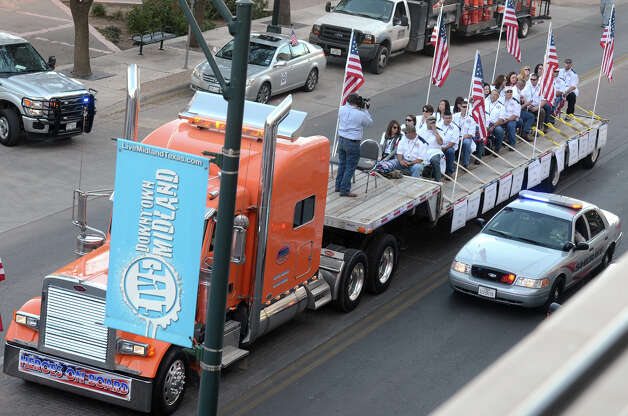 "A flatbed truck carries wounded veterans and their families during a parade before it was struck by a train Thursday, Nov. 15, 2012 in Midland, Texas. ""Show of Support"" president and founder Terry Johnson says there are ""multiple injuries"" after a Union Pacific train slammed into the trailer, killing at least four people and injuring 17 others. (AP Photo/Reporter-Telegram, James Durbin) Photo: James Durbin, MBO / Reporter-Telegram"
